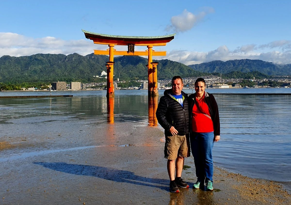 Anne and Tony visiting the floating Torii Gate on Miyajima Island in Japan